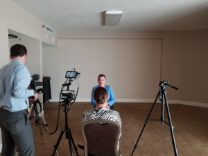 Amy Brin, CEO & Executive Director, preparing for on camera interview